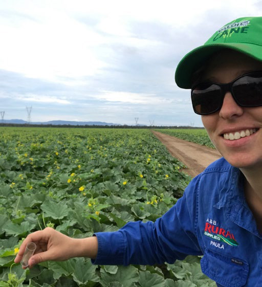 BGA AgriServices Paula Mizzi in field releasing wasp
