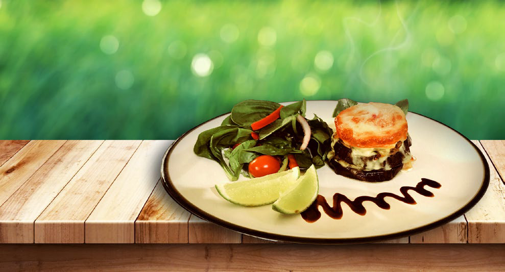 Rustic Lamb Sliders on a plate with vegetables and lime